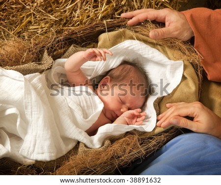 20 days old baby sleeping in a christmas nativity crib