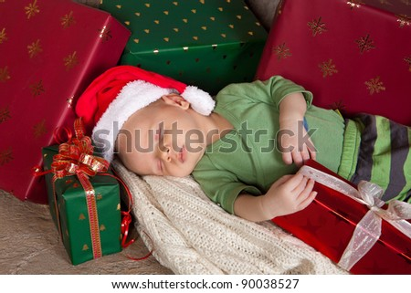 18 days old baby sleeping with christmas presents