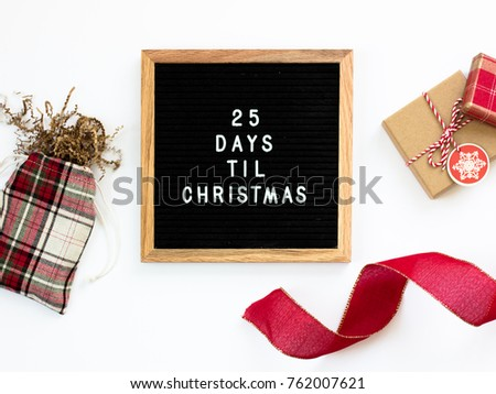 25 Days Til Christmas. Christmas countdown letter board with gifts and ribbons. #762007621