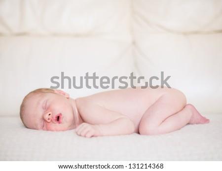 11 days young baby. Sleeping baby boy.