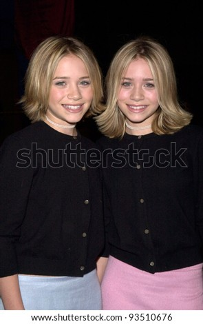 """15DEC99: Actress twins MARY-KATE & ASHLEY OLSEN at the Los Angeles premiere of """"Anna and the King"""" which stars Jodie Foster.  Paul Smith / Featureflash - stock photo"""