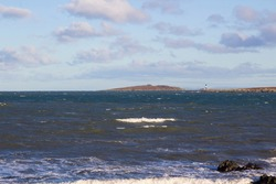 24 December 2020 A view of the rough seas across the Copeland Sound towards the Copeland Islands an a bright winter afternoon. The Mew Island Lighthouse  is located in the sound close to the Mainland