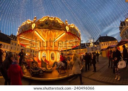 24 December 2014 SIBIU, ROMANIA. Christmas lights, Christmas fair, mood and people walking. Fish eye lens effects #240496066