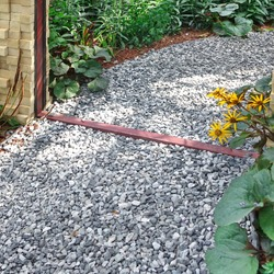 Decorative Garden With Pathway Or Walkway From Stone And Rocks Or Gravel. Back Yard Or Park Lawn With Stony Natural landscaping. Backyard Garden Modern Design Landscaping. Landscaped Back Yard.