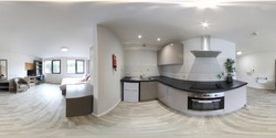 360 Degree Full Sphere Panoramic photo of a modern newly built house interior kitchen showing new kitchen appliances.