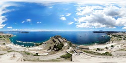 360 Degree panoramic sphere photo taken in the beautiful coastal area of Corfu one of the Greek Island in Greece, taken with a drone at the old Venetian Fortress with boats in the port town Corfu