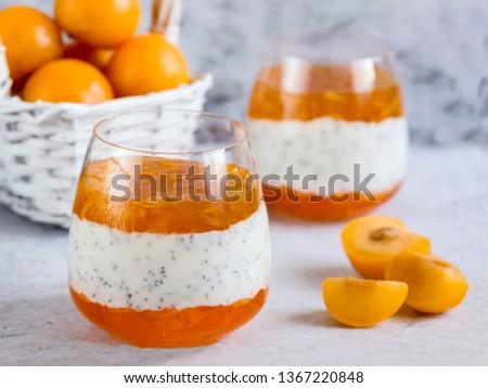 Delicious yogurt dessert with Chia berries, yellow plum jam and jelly. Healthy Breakfast, light snack. Horizontal. #1367220848