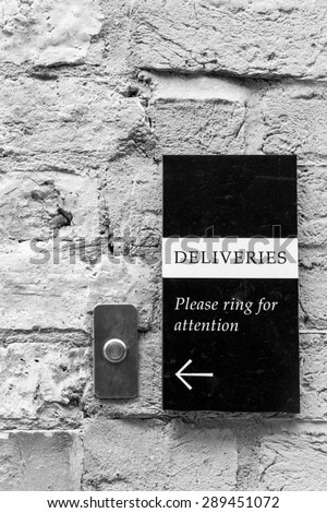 \'Deliveries\' \'Please ring for attention\'  bell and sign on an old wall conceptual image