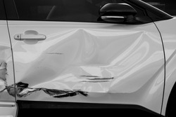 dents on the car door caused by the accident