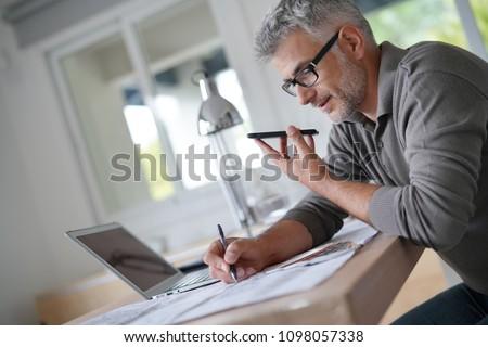 Designer in office talking on phone