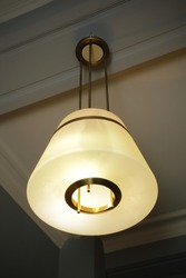 designer light fixture on the ceiling of an old house Europe 1900