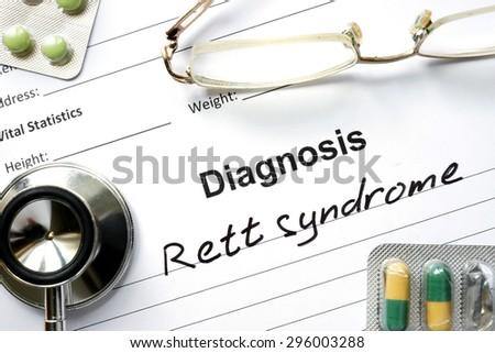 Diagnosis  Rett syndrome, pills and stethoscope. Stock fotó ©