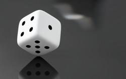 dice on reflective black background.