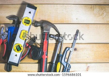 diferent tools in a wooden background color yellow