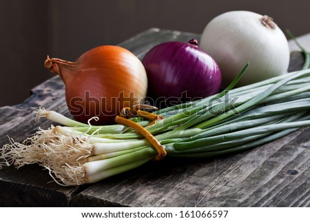Different Onions On Wood