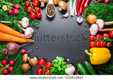 Different raw vegetables and spices on black background. Healthy eating. Autumn harvest and healthy organic food concept. #526816864