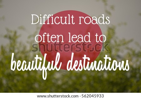 """Difficult roads often lead to beautiful destinations"" text on blurry nature background. Motivation concept. #562045933"