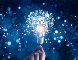 Digital marketing. Hand holding light bulb, innovation technology, business  icons on network connection, dark blue background