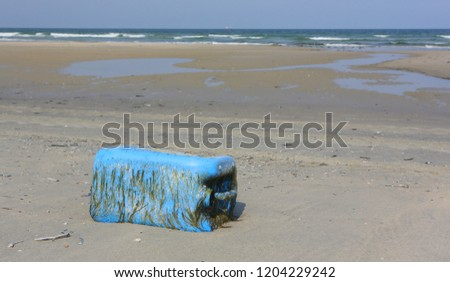 Dirty sea sandy shore the North Sea. Environmental pollution. Ecological problem. Bokeh moving waves in the background #1204229242