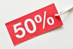 50% discount on red tag and white background. Concept in business - time for discounts and promotions.