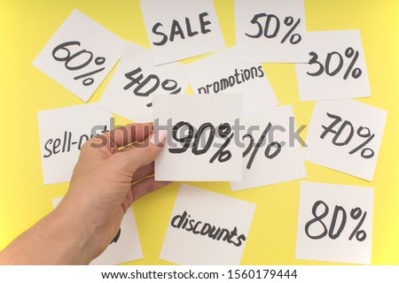 90% discount selection from many discounts lying on a colored background.