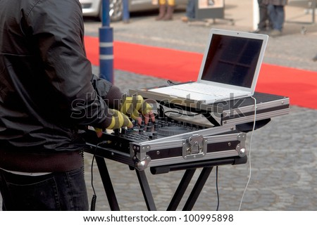 Dj playing disco house progressive electro music in a street party