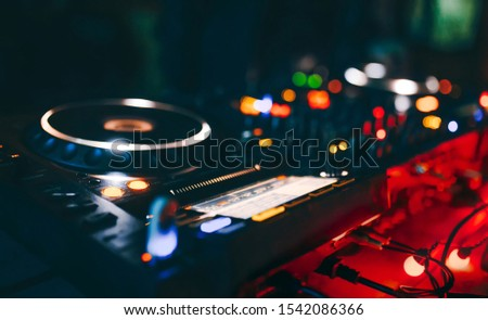 dj turntables player device with sound mixer panel and jog wheel. Club disc Nightclub party.