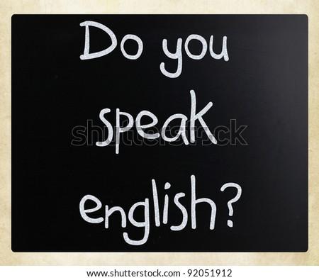 """Do you speak english"" handwritten with white chalk on a blackboard"