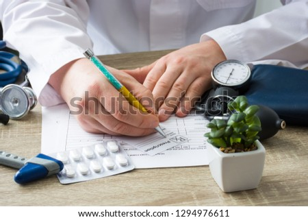 Doctor in hospital office prescribe prescription medication to patient who came to appointment. Control and monitoring of discharge of prescription drugs for pharmacotherapy pharmaceutical treatment