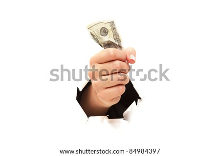 100 dollar bill in fist through paper hole isolated