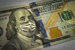 100 dollar bill. Medical mask. Coronavirus Economic crisis.