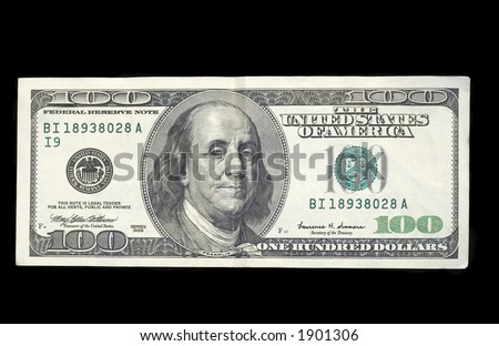100 dollar bill, on a black velvet background. The largest denomination available in the U.S.A.