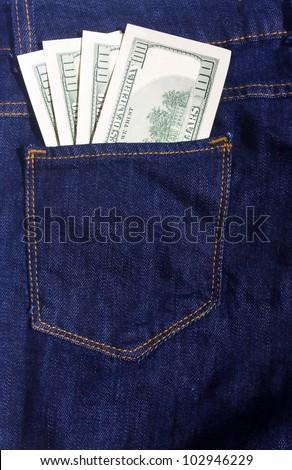 100-dollar bills in the pocket of blue jeans
