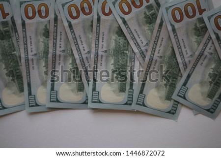 100 dollar bills on a white background. Pile of new one hundred dollar bills bills.