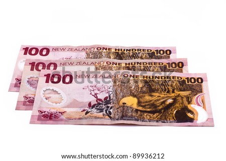 100 Dollar notes in New Zealand currency, isolated over white background.