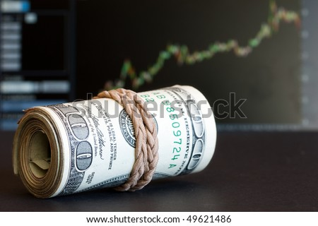 100 dollar notes with graph as the background