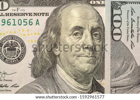 100 dollars bills close-up and portrait of Benjamin Franklin on US cash bill