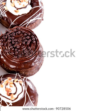 Donut with chocolate and peanut against white background
