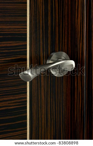 Door knob on the wooden door. Close up