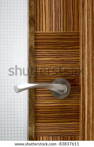 Door knob on the wooden door. Close up
