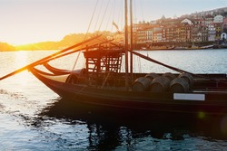 Douro river and traditional port wine boats at sunset, Portugal