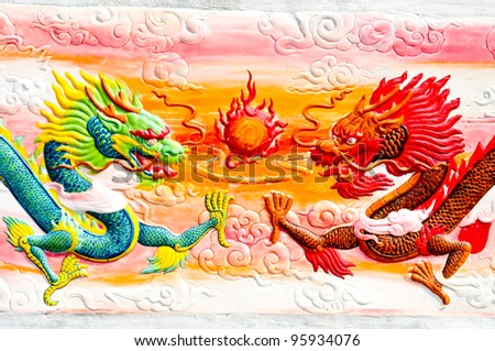 dragon statue in Chinese temple. Dragon painting in Wat Thai ,wonderful art Thailand