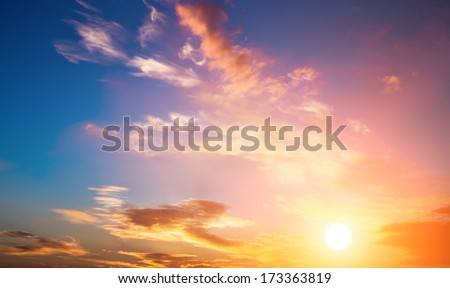 Dramatic sunset sky with orange colored clouds and sun. #173363819