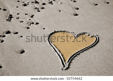 Drawing of a heart on sandy beach
