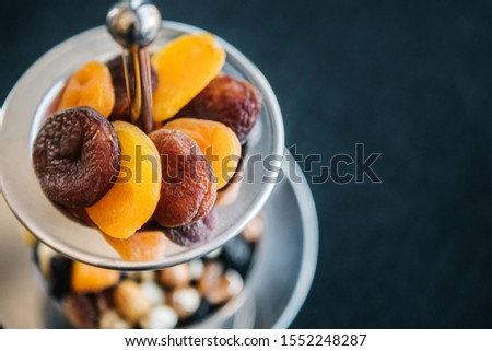 dried apricots and dried fruits on presentation plate #1552248287