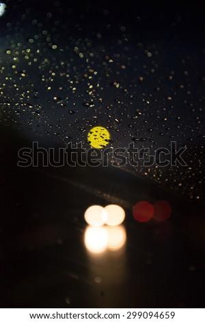 Driving car during raining . Night shot