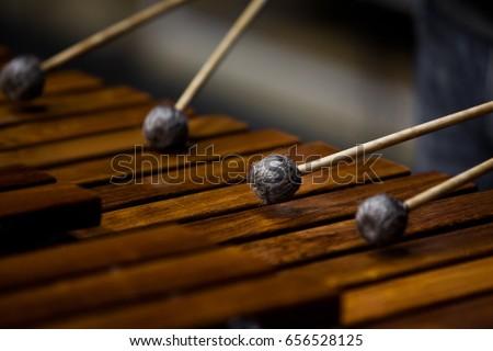 Drum sticks hitting the marimba closeup