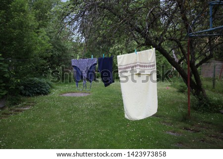 Drying clothes. Clothes are drying in summer garden. Village house