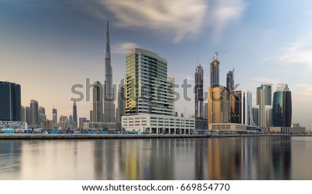 Dubai, UAE - January 01, 2017: Dubai Downtown view on sunset as shot over the Dubai water canal #669854770
