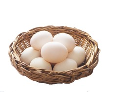 duck eggs are placed in a bamboo basket.